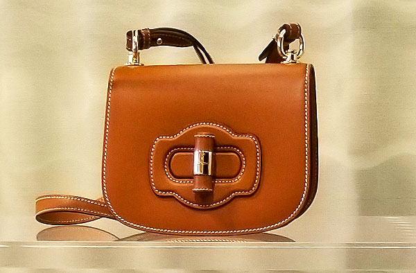 A perfect chic bag from Prada sleek in neutral colors