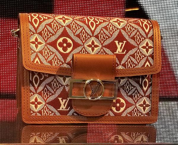 Rust Vuitton bag