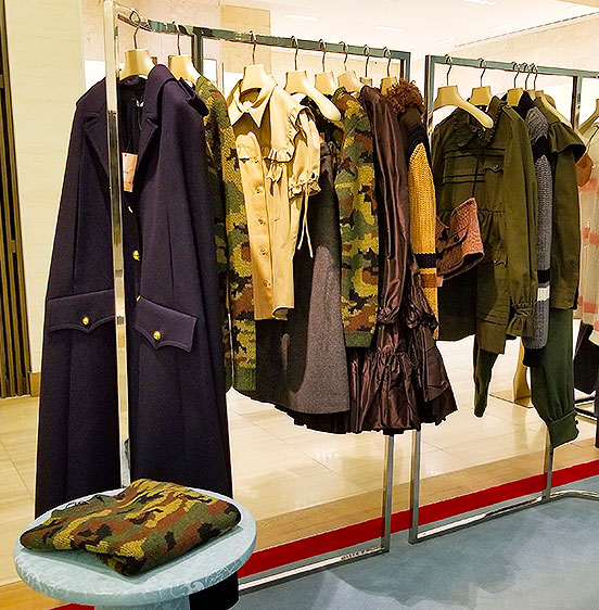 Make Militaray Green your new fall look in these Miu Miu items of clothing