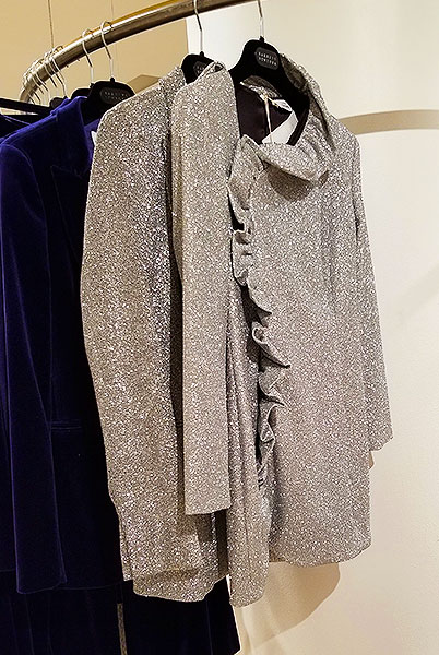 A silver blouse and jacket