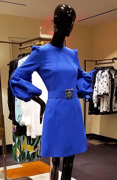A royal Blue dress sings