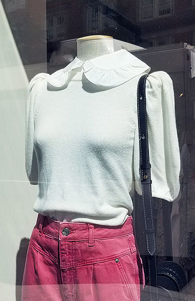 Crisp collared sweater with collar stories