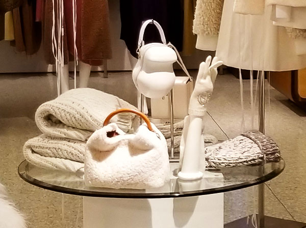 Bags and sweaters in white
