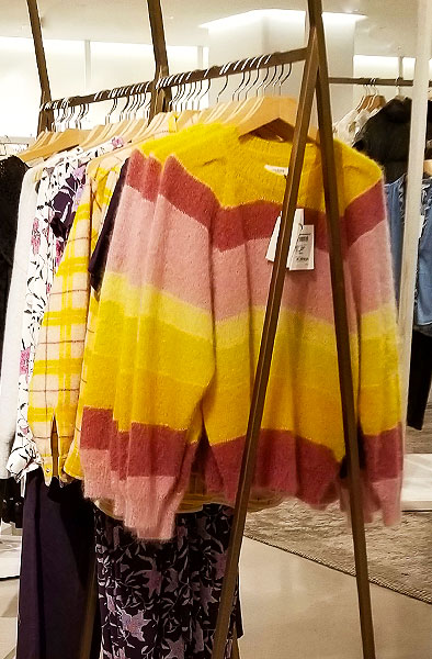 wear a brighly striped sweater