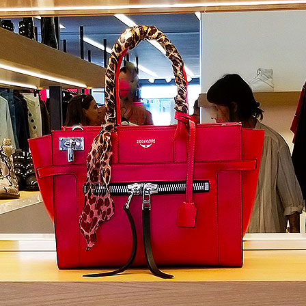 Wear red with this handbag